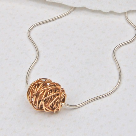 Entwined Bead in Yellow Gold on Silver Snake Chain