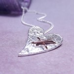 IndiviJewels Sterling Silver Torn Heart Necklace Close up