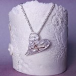 IndiviJewels Sterling Silver Torn Heart Necklace Hanging