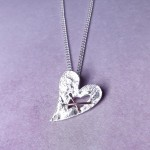 IndiviJewels Sterling Silver Torn Heart Necklace Hanging 2