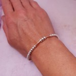 IndiviJewels 30th Birthday Bar Bracelet with Rose Gold Bar being worn