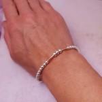 IndiviJewels 30th Birthday Bar Bracelet with Rose Gold Bar being worn